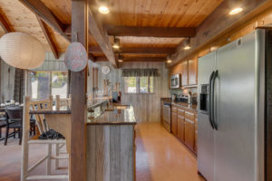 NEW LISTING – ENJOY OUTDOOR LIVING WITH FILTERED VIEWS OF LAKE ON THE WEST SHORE